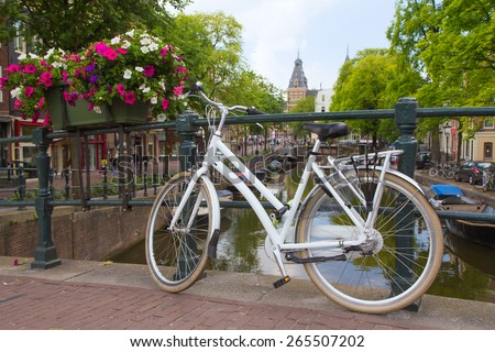AMSTERDAM, NETHERLANDS- JUN 26: The bicycle is very used mode of transport in Amsterdam. Over 60% of trips are made by bike in Amsterdam. On June 26, 2014  in AMSTERDAM, Netherlands.