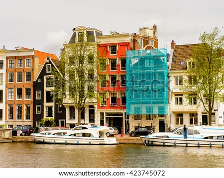 AMSTERDAM, NETHERLANDS - JUNE 1, 2015: Architecture of canals of Amsterdam, Netherlands. Amsterdam is the capital of Netherlands and a popular touristic destination