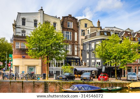 AMSTERDAM, NETHERLANDS - JUNE 1, 2015: Architecture of the canals of Amsterdam, Netherlands. Amsterdam is the capital of Netherlands and a popular touristic destination