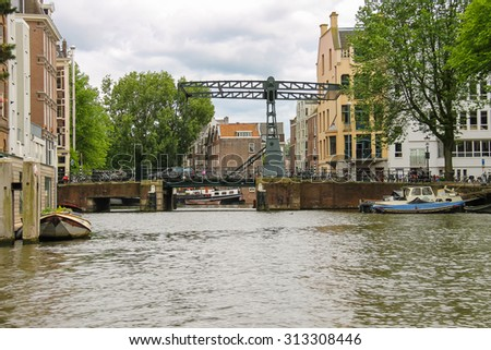 Amsterdam, Netherlands - June 20, 2015: Bascule bridge on the canal in Amsterdam