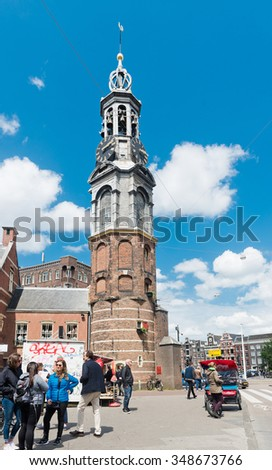AMSTERDAM, NETHERLANDS - JUNE 01, 2015:  People at The Munttoren (Mint Tower) Muntplein square in Amsterdam, This tower was once part of one of the three main medieval city gates - stock photo
