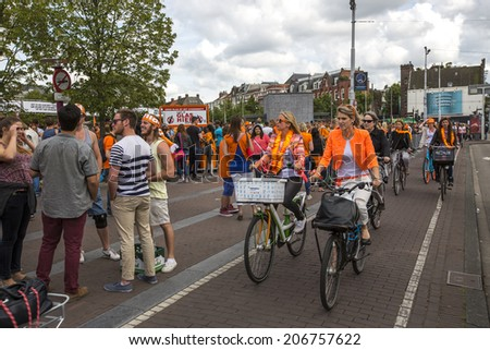 Amsterdam, Netherlands - June 29: People riding bicycles in Amsterdam, Netherlands on June 29, 2014.