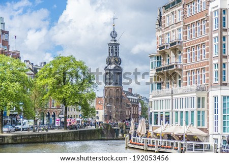 AMSTERDAM, NETHERLANDS - JUNE 15, 2013: The Munttoren (Mint Tower) Muntplein square, where the Amstel and the Singel canal meet, near the flower market and the end of Kalverstraat shopping street. - stock photo