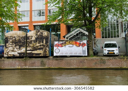 Amsterdam, Netherlands - June 20, 2015: Trade booths on the market Waterlooplein decorated historical photos. Amsterdam - stock photo