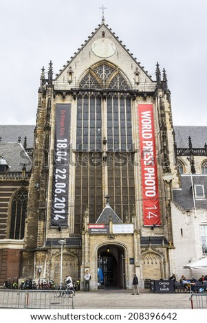 AMSTERDAM, NETHERLANDS - JUNE 17, 2014: View of the Nieuwe kerk (New church) located on Dam square, next to Royal Palace. The building used for exhibition, organ recitals and as museum. - stock photo