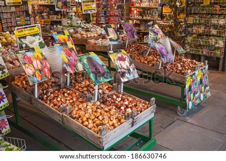 AMSTERDAM, NETHERLANDS - MARCH 19, 2014: Decorative flower bulbs and seeds on the counter of the biggest floating market in Amsterdam