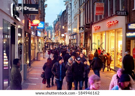 AMSTERDAM, NETHERLANDS - MARCH 01, 2014: Unidentified people walking on Kalverstraat - main shopping street of Amsterdam. The Kalverstraat is the most expensive shopping street in the Netherlands. - stock photo