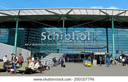 AMSTERDAM, NETHERLANDS - MAY 30: The main entrance of Amsterdam Airport Schiphol on May 30, 2014 in Amsterdam, Netherlands. It is the Netherlands' main international airport.  - stock photo