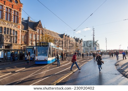 AMSTERDAM, NETHERLANDS - NOVEMBER 13: Amsterdam Centraal station on November 13, 2014 in Amsterdam, the largest train station of Amsterdam and a major national rail hub with 260,000 passengers a day - stock photo