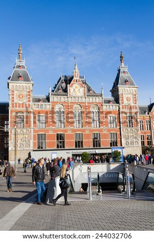 AMSTERDAM, NETHERLANDS - NOVEMBER 09:Amsterdam Central Train Station on November 09, 2014 in Amsterdam .Every day 250,000 go through Amsterdam's Central Station. - stock photo