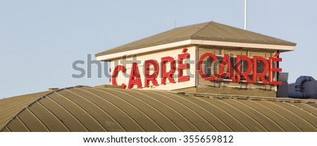 AMSTERDAM, NETHERLANDS - NOVEMBER 26: Letters on the exterior of Royal Theater Carre, the official theatre of Amsterdam, on November 26, 2015 in Amsterdam, Netherlands. - stock photo