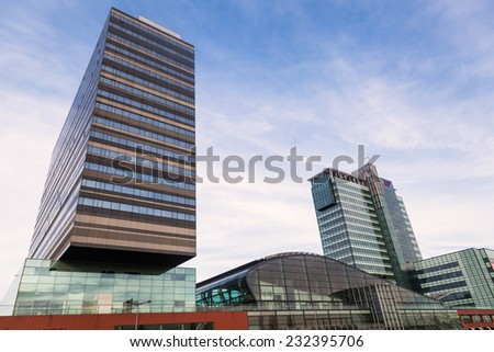 AMSTERDAM, NETHERLANDS - NOVEMBER 13: Passenger Terminal Amsterdam on November 13, 2014 in Amsterdam. Its the citys official port for cruise ships with about 200,000 passengers annually  - stock photo