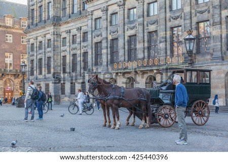 AMSTERDAM, NETHERLANDS - OCTOBER 11, 2015:Royal Palace in Amsterdam on the Dam Square in the afternoon. The Netherlands - stock photo