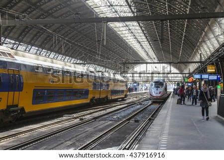 AMSTERDAM, NETHERLANDS on APRIL 1, 2016. Railway station. The modern high-speed train at the platform. Passengers go to departure