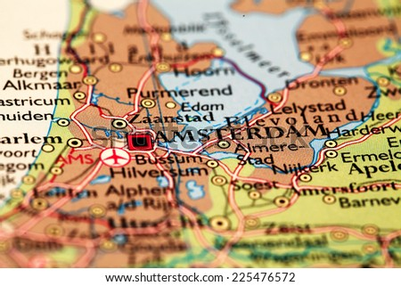 Amsterdam Netherlands, on atlas world map - stock photo