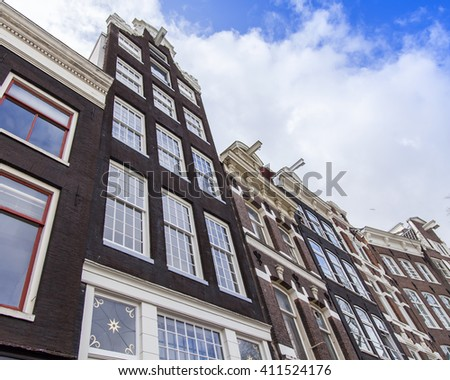AMSTERDAM, NETHERLANDS on MARCH 27, 2016. Typical architectural details of houses XVII-XVIII of construction.