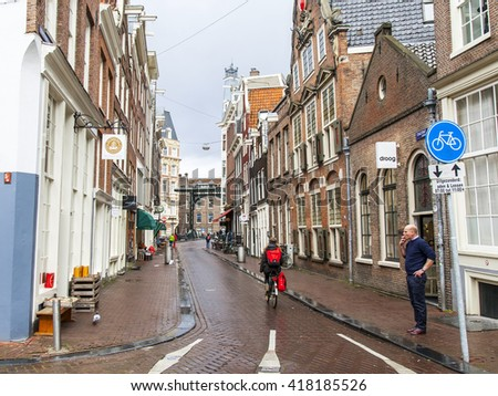 AMSTERDAM, NETHERLANDS on MARCH 28, 2016. Typical urban view in the spring afternoon.