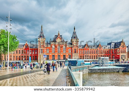 AMSTERDAM, NETHERLANDS - SEPTEMBER 15, 2015: Beautiful buildings Amsterdam Central station.(Station Amsterdam Centraal). Amsterdam Centraal was designed by Pierre Cuypers - stock photo