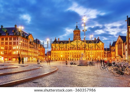 AMSTERDAM, NETHERLANDS - SEPTEMBER 15, 2015:Royal Palace in Amsterdam on the Dam Square in the evening. Netherlands - stock photo