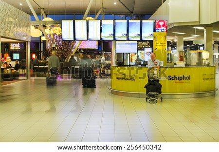 AMSTERDAM, NETHERLANDS - SEPTEMBER 27: Schiphol Airport terminal interior on September 27, 2014 at Schiphol Airport, Amsterdam, Netherlands. Schiphol Airport was Europe's 5th busiest in 2014. - stock photo