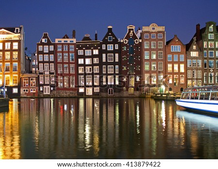 Amsterdam night view. Canal and old buildings. Netherlands