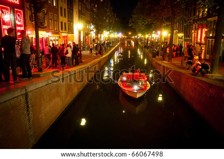 AMSTERDAM, NL - AUG 5: De Wallen is the largest and best-known red-light district in Amsterdam and a major tourist attraction, on August 5th 2010 in Amsterdam, Netherlands