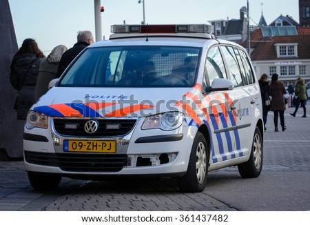 Amsterdam, Noord-Holland/Netherlands - January 08-01-2016 - Police car parked in front of Amsterdam central station. The dutch Police Service has a key role in protecting Amsterdam from terrorism. - stock photo