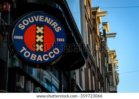 Amsterdam, North Holland, The Netherlands -January 8, 2016: souvenirs and tobacco sign, taken in one of the main streets of Amsterdam.