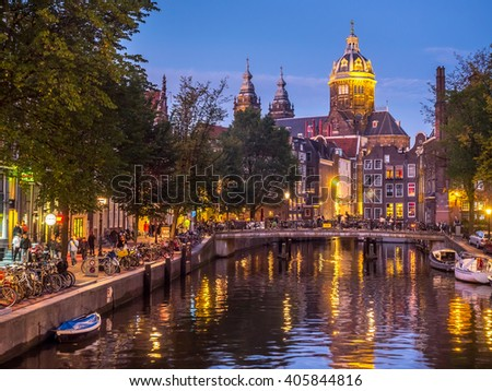 AMSTERDAM - OCTOBER 2: Saint Nicholas church from bridge at Red-light district under twilight evening sky in Amsterdam, Netherlands, on October 2, 2015.