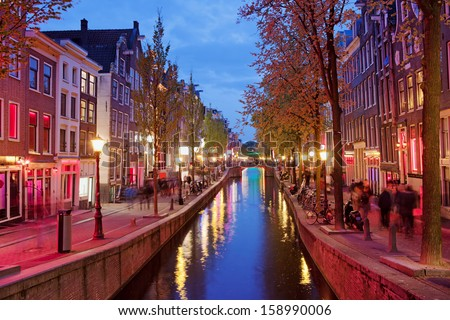 Amsterdam Red Light District area in the city centre at dusk, North Holland, the Netherlands. - stock photo
