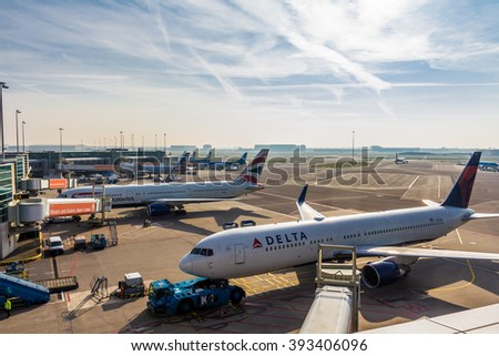 Amsterdam Schiphol Airport, North Holland/the Netherlands - March 10 2016: passenger aircraft parked at the gates of Schiphol airport