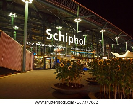 AMSTERDAM - SEPTEMBER 07 2012: Amsterdam city airport Schiphol at night. September 7, 2012 in Amsterdam. Holland. - stock photo