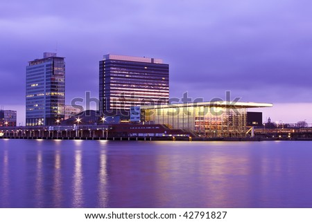 Amsterdam skyline with the musicbuilding at the IJ in the Netherlands - stock photo