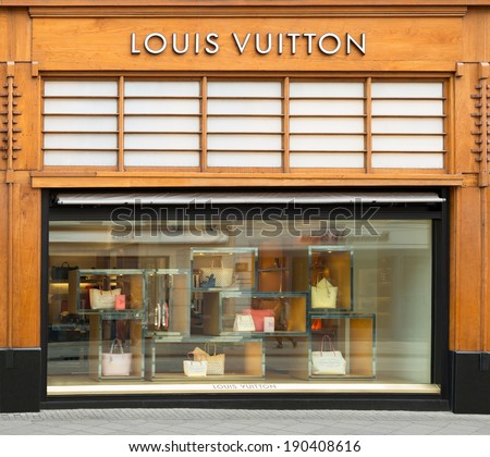 AMSTERDAM, THE NETHERLANDS - APRIL 26, 2014: Louis Vuitton store in the P.C.Hooftstraat, shopping street in Amsterdam. The French fashion house is founded in 1854.