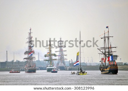 AMSTERDAM, THE NETHERLANDS, 19 AUGUST 2015 - Old tall ships sailing into the Port of Amsterdam during Sail 2015. - stock photo