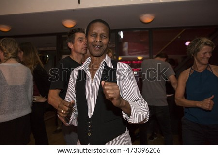Amsterdam, The Netherlands - August 20 2016: people dancing at the opening party of World Cinema Amsterdam festival at Rialto Cinema, a world film festival held from 18 to 27/08/2016