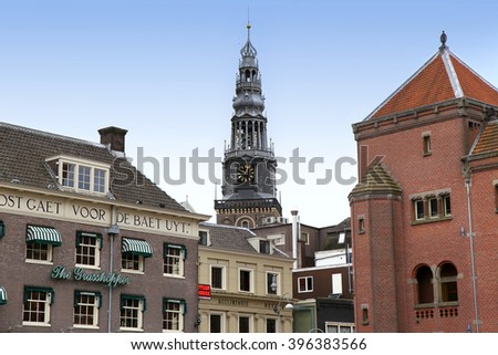 AMSTERDAM; THE NETHERLANDS - AUGUST 16; 2015: View of Oude Kerk (Old Church) from Damrak canal. Amsterdam is capital of the Netherlands on August 16; 2015. - stock photo
