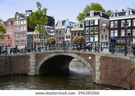 AMSTERDAM, THE NETHERLANDS - AUGUST 18, 2015: View on Prinsengracht from Spiegelgracht. Street life, Canal, pedestrians and bicycle in Amsterdam, Netherlands on August 18, 2015. - stock photo