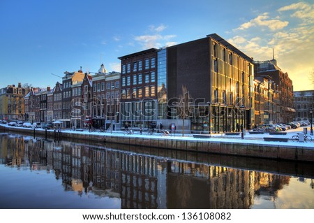 AMSTERDAM, THE NETHERLANDS - CIRCA JAN. 2013: Anne Frank house and holocaust museum in Amsterdam, the Netherlands, on a sunny morning circa Jan. 2013. Anne Frank house is a popular tourist destination - stock photo
