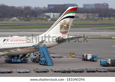 AMSTERDAM, THE NETHERLANDS - 23 FEBRUARY : Boeing from etihad airways parking at the passengers terminal at Schiphol Airport february 23, 2014 in Amsterdam,The Netherlands.  - stock photo