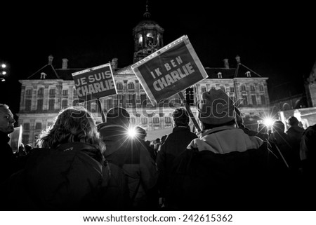 """Amsterdam, The Netherlands, January 08 2015: demonstration in solidarity with the attack against Charlie Hebdo in Paris, France on 07 January, people holding a sign sauing """"I am Charlie"""" - stock photo"""