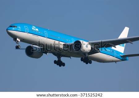 AMSTERDAM, THE NETHERLANDS--11 JUNE 2015-- A KLM Boeing 777 airplane is landing towards the runway.
