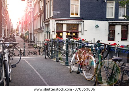 Amsterdam The Netherlands  - June 16: Bicycles parked on a bridge in Amsterdam June 16, 2015. - stock photo