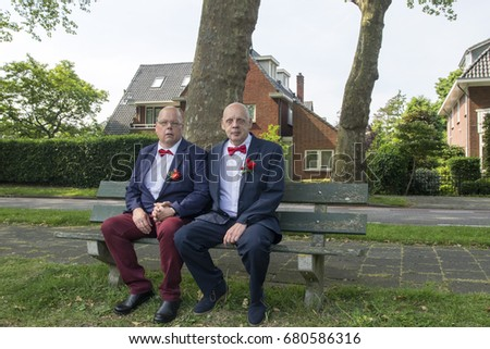 Amsterdam, the Netherlands, June 2, 2017, Married Couple Sitting on A Park Bench