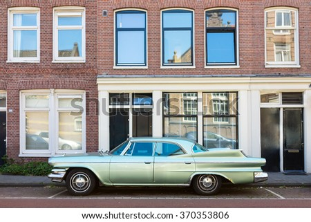 Amsterdam The Netherlands - June 11: Old classic car Dodge Matador, year of fabrication 1960. Parked on the road side in Amsterdam, side view  on June 11, 2015.  - stock photo
