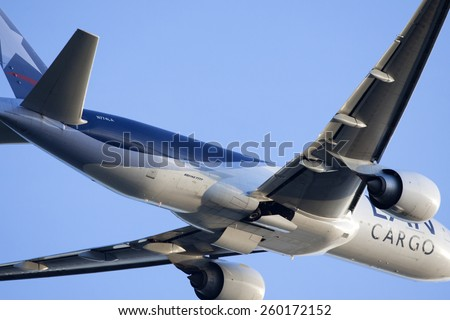 AMSTERDAM, THE NETHERLANDS - Maart 11, 2015 :Closeup photo of a .Boeing 777-300ER from LAN Cargo is one of the 10 Boeing 777 that has this airline  On maart 11 , 2015 in Amsterdam, Holland.  - stock photo