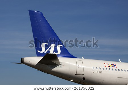 AMSTERDAM, THE NETHERLANDS - Maart 11, 2015 : ITail of a Boeing from sas ( airline Scandinavian Airlines System  and  In the background a cloudless blue skyOn maart 11 , 2015 in Amsterdam, Holland.