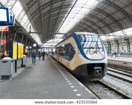 Amsterdam, The Netherlands - MAY 2016 : Amsterdam Centraal station is the largest railway station of Amsterdam, Netherlands, and a major national railway hub. Used by 260,000 passengers a day,