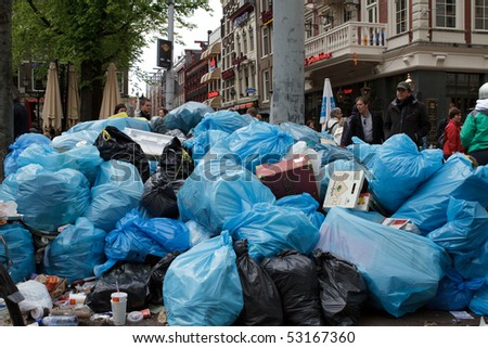 AMSTERDAM, THE NETHERLANDS - MAY 15: Garbage pile up during the week long workers strike that ended today May 15, 2010, in Amsterdam, The Natherlands - stock photo