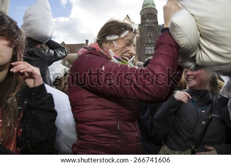 Amsterdam, The Netherlands, Noord Holland - Saturday, April 4 2015 - Pillow Fight on Dam Square as part of the international pillow fight day held in several cities in the world - stock photo